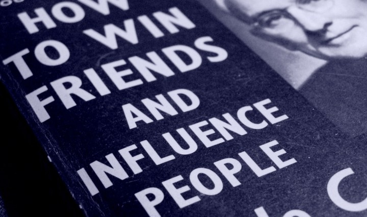 An image showing a book cover for 'How to win friends and influence people'.
