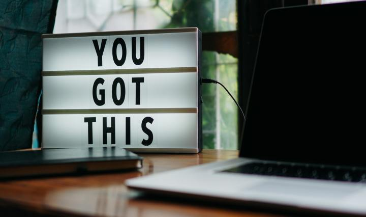 An image of a sign saying, 'you got this' next to a laptop.