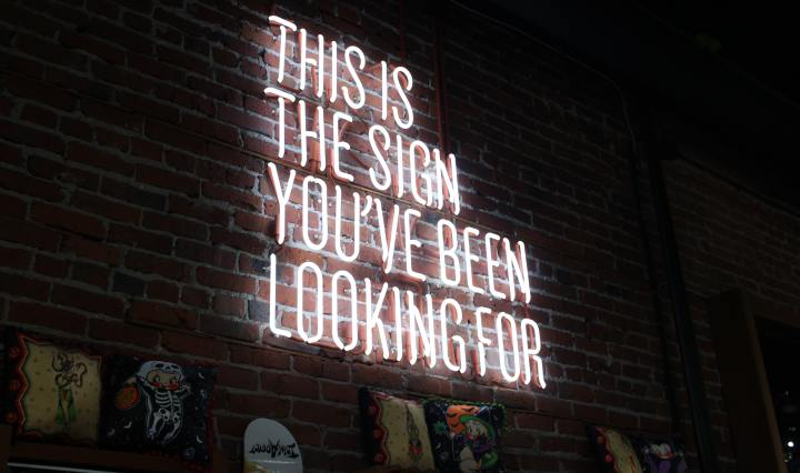 An image of a neon sign saying, 'this is the sign you've been looking for'.