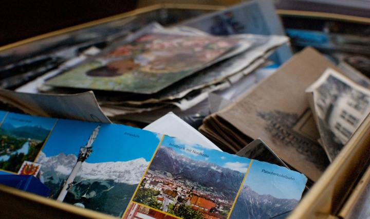 An image of a box of photos, postcards and assorted memories.