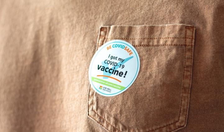 An image of a sticker on a shirt saying, 'I got my COVID-19 vaccine!'.