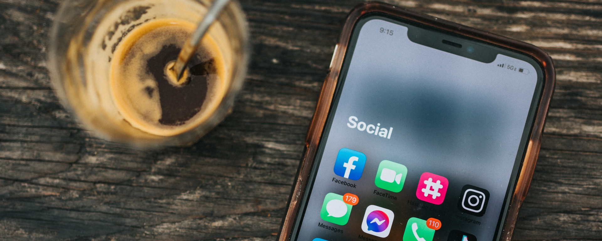 An image of an espresso shot and a phone with a set of social media app icons.